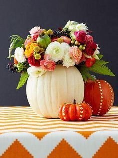 30 Genius Halloween Decoration Ideas - studded pumpkin + white painted pumpkin used as a flower vase