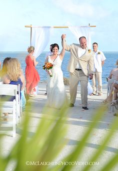 Photography by McLaughlinPhotoVideo.com.  Beach Wedding at Postcard Inn, Islamorada, FL.  Florida Keys Wedding Photography