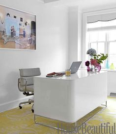 In the office of this whimsical Greenwich Village apartment, designer Fawn Galli chose a Ligne Roset desk to sit on a Madeline Weinrib rug. Jonny Valiant  - HouseBeautiful.com