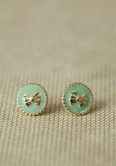 Bow earrings, with the mint green sweater!!!