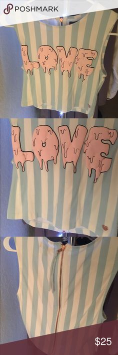 """Kendall & Kylie Jenner LOVE crop top this is a sleeveless, cropped shirt with the word """"LOVE"""" 3D printed in light pink coloring with a black outline. The shirt has light blue stripes with a white background. The shirt has rose gold detailing such as the zipper on the back, and the heart logo on the bottom right corner of the shirt  🌸🌸🌸🌸🌸 worn two or three times! great condition! 🌸🌸🌸🌸🌸 Kendall & Kylie Tops Crop Tops"""
