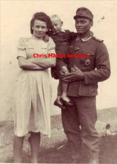 """LET ME BLOW YOUR MIND...This is photo of a soldier,(German father, African mother). His father was a colonial administrator in German SW Africa (now Namibia). When the official returned to Germany, he took his son with him. This is the man while serving in the army of """"NAZI GERMANY'! His wife, was a mixed German from the Rhineland. The hair & features on both of them clearly show a mix of African & caucasian ancestry...& he was NOT the only one in the German Army! """"...the more you know"""""""