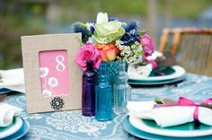 Colored Vases At Wedding- incorporating the coral/teal.