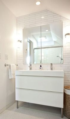 Ikea Godmorgon cabinet in gloss white with Braviken sink. Wall sconces from Restoration Hardware. Photo by Andrew Hyslop; subway tile & hex on floor Bathroom Cabinets Ikea, Ikea Bathroom Vanity, Bathroom Niche, Small Bathroom Vanities, Bathroom Renos, Bathroom Interior, Modern Bathroom, Bathroom Remodeling, White Bathroom