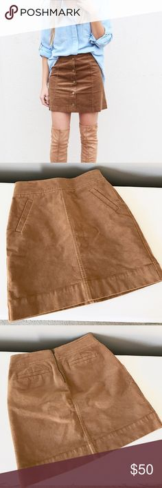 Tan Cord Skirt By Ann Taylor Loft size 00 petite. Worn once! Stock photo is just an example of the fit and color almost identical minus the front buttons. 98% cotton 2% spandex. Length is 17 inches hips are 17 inches across and waist is 13.5 inches across the top laying flat. NO TRADES don't ask. NO holds or modeling. Smoke free pet free. Also listed on merc for less and FREE shipping. Bundle and save even more with my discount! LOFT Skirts Mini