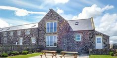 With sea views across Embleton Bay, Granary Stone House is a large, secluded holiday home on the Northumberland Coast. This pet friendly cottage sleeps 12.