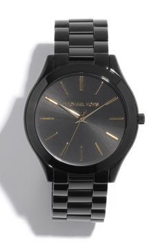 Shiny and sleek. Smitten with this black and gold Michael Kors slim runway bracelet watch.