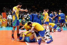 #olympics #olympiad #olympians  Brazilian players rejoiced after their three-game victory over Italy in the men's volleyball gold medal match. Volleyball is the second most popular sport in Brazil, which also took home the men's gold medal in the country's most beloved sport, soccer. The United States won the bronze medal in men's volleyball, beating Russia in five games.   Mark Kolbe/Getty Images