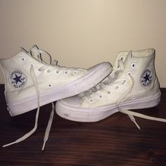 Used all white high top converse with lunarlon These all white used high top converse have lunarlon cushion for extra support and comfort. They are super cute and go with pretty much anything. As shown in the picture they have marks on them but nothing a little clearer can't fix. These shoes says they're a U.S 6.5 but they run pretty small and are kinda tight around the toe but if that's your size then I'm sure they'll fit fine. they're just waay too small for me. Ask me any questions you…
