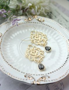 ♥´¨) ¸.•´ ¸.•*´¨) (¸.•´ ♥ ~ Gorgeous large matte gold plated moroccan inspired filigree earrings. Organic with a raw finish. A gold plated over brass framed grey glass drop dangles beneath. They hang on gold plated over brass french ear wires. Total length of earrings is approximately 2 1/2 inches long. These Large filigree pendants measures approximately 35 x 40mm. They are great for everyday wear or as a gift for someone special :)  Available in matte silver finish as well…