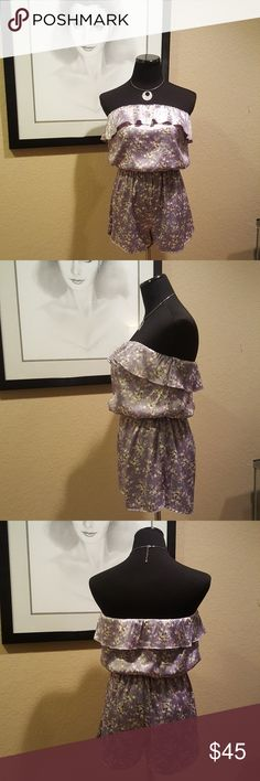 """Moon Collection Purple Lavender Satin Romper Darling purple floral pattern, satin romper, elasticized waist with ruffled elasticized neckline is in excellent vintage condition!!!    Brand:  Moon Collection  Size Medium (See measurements for sizing also)  32"""" bust  25"""" waist, un-stretched, 34"""" waist, stretched  13"""" long shorts  22"""" long Moon Collection Shorts"""