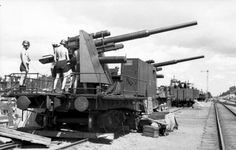 Railway Flak 88 guns somewhere in Germany in the summer of 1943. The railway platform was a quick solution to the need to disperse AA capability according to developing regional needs. Moving the guns by road required much bigger effort and amounts of fuel Germany could not afford. Given the sophisticated railway network of the country, the movement by train made perfect sense.