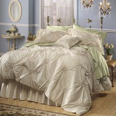 $139.95 Lisette Smocked Comforter Set Set includes: Comforter in blue Shams with petite ruffle edging (2 king with king) Fully gathered bedskirt