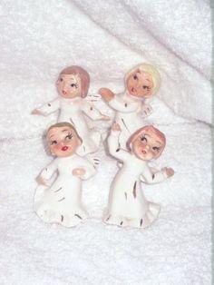 Vintage Christmas DANCING Angel set of four figurine decoration ornament porcelain Lefton Napco Japan. $25.00, via Etsy.