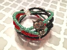 A personal favorite from my Etsy shop https://www.etsy.com/listing/274166244/beaded-cuff-bracelet-mint-green-coral