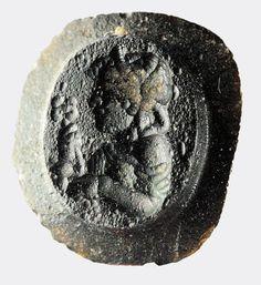 Sello del vidrio romano que representa una ménade