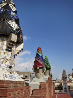 Climb out onto the rooftop terrace to walk amidst the 20 chimneys (notice the Trencadís mosaic designs made with broken glass and shards of glazed tile).  Follow the link to find out more about Palau Guell!  http://mikestravelguide.com/things-to-do-in-barcelona-visit-palau-guell/