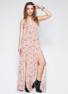 Floral print maxi dress from Somedays Lovin featuring mesh side detail and slits at front.  100% Rayon 57 length Model is wearing size XS