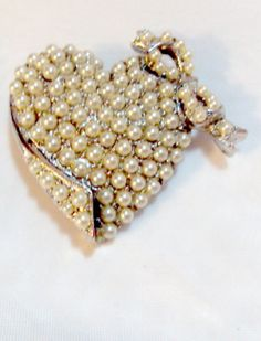 Vintage Faux Pearl Heart Pin Brooch.  Silver tone and could be rhodium covered with faux pearls. Very nice condition. Measures 1 1/2 inches.    Thank you for opening the do... #bitzofglitz4u #teamlove #vogueteam