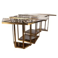 Italian brass and smoked glass dining table | From a unique collection of antique and modern dining room tables at https://www.1stdibs.com/furniture/tables/dining-room-tables/