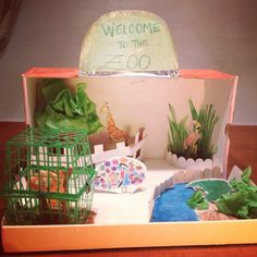 Creating a zoo diorama from a shoe box and strawberry basket. #CreativeSitters