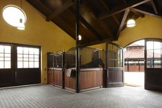 Corner horse stall. The timber is from Dreaming Creek Timber. Horse stalls by Lucas Equine.