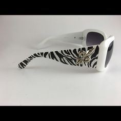 Black & White Zebra w/ Flor De lis. New never warn very cute shades just not my style. Accessories Sunglasses