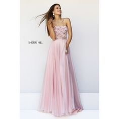 Sadie Robertson by Sherri Hill Prom Dress Part of the Sadie Robertson Live Original collection. Yards and yards of whisper-thin material sweep down over the slightly flared floor-length skirt for a dreamy, airy look. The bodice explodes in glittery excitement with delicate beaded patterns. It is all topped off with a simple strapless neckline. Has been worn once and altered. Comes with extra beads incase some fall off. Fits size 2-4. Style 11075. Sherri Hill Dresses Maxi