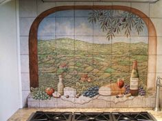 """Portuguese Vista-Solberg Vineyards"" Based on photos from client featuring typical Portuguese foods, landscape or vista and custom wine bottle label. Custom designed decorative kitchen backsplash tile mural. Hand painted on 6 x 6 inch ceramic tile. Dimensions are: 48 inches wide x 36 inches high."
