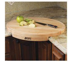 Corner cutting board fits at corner of counter.
