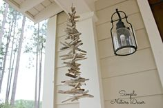 For more Driftwood Garland Decor Ideas, go to Completely Coastal: http://www.completely-coastal.com/2013/09/driftwood-garland.html
