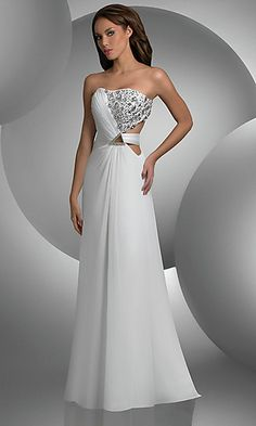 This Bari Jay designer prom dress has an understated elegance that is perfect for your prom or formal. Silver crystal accents sparkle on the strapless bodice and a seductive side cut out adds to the glamour. Available in Ivory, Ocean Blue, or Purple this elegant evening gown is exquisite and knowing it's from the Bari Jay prom dress collection guarantees you a high quality design.