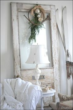 DIY:  Reuse a salvaged door - lean it in the corner of the room.  It adds height and you can use it to display seasonal decor - no additional holes in the wall.