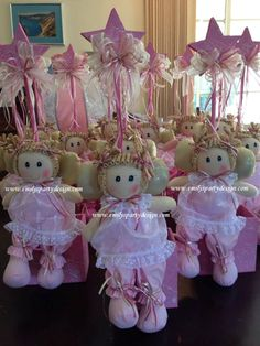"""Adorable Angel Centerpiece Mounted on a wooden box ((5.3/4 W X 5.3/4 inches height), these angels are 100% handmade. Angels pictured here meausre 13"""" x 9"""" tall while the accompanying star is 23"""" in height. The price includes customizing for your event."""