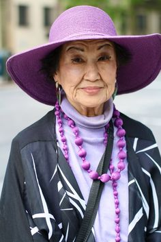 """ADVANCED STYLE: """"I saw this woman downtown and loved her matching necklace and hat. She told me that she was an artist and that she loved the color purple."""""""