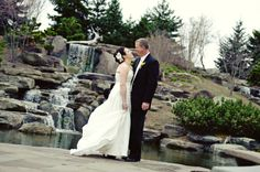 Bride and Groom near waterfall at Frederik Meijer Gardens in Grand Rapids, MI. [Matt Pratt Photography]