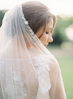 A blushing bride in floral lace.