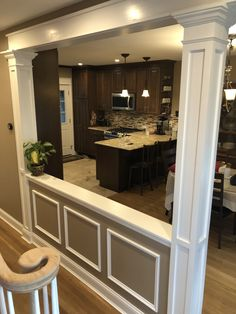 load bearing wall, half wall with decorative columns and picture frame molding Wall ideas Interior Columns, House, Home, Half Walls, Living Room Remodel, Home Remodeling, House Interior, Half Wall Room Divider, Kitchen Columns