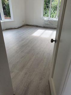 Pergo water-resistant Studio Oak flooring. Beautiful in any sitting room.