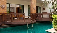 Extravagant Modern Wooden Deck Hotel With Pool In Room Design Equipped With Wooden Deck And Stainless Steel Staircase With Green View