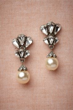 """Candela Earrings    The cool glow of a single pearl reflects off of Swarovski crystal teardrops, drawing the eye to its understated light. Handmade by Ben-Amun. 1.5""""L, 0.75""""W. Post closure. Pewter, antique silver plate, Swarovski crystals, glass pearls. USA."""
