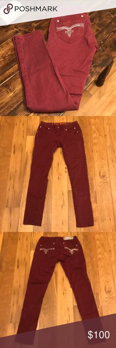 """Maroon Rock Revival Skinny Jean One of a kind Maroon Rock Revival Skinny jean. All sequins on pocket. 30"""" inseam. Could be cuffed to a cropped skinny or Capri. No missing stones on pockets. These are like new condition. Rock Revival Jeans Skinny"""