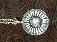 Sunflower silver clay pendant