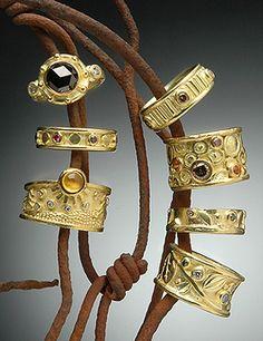 Hughes-Bosca  - Rings. black, cognac, green, blue & white diamonds also yellow & pink sapphires.