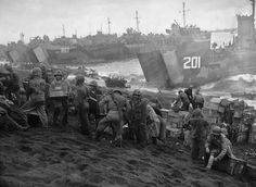 U.S. Coast Guard and Navy vessels landing supplies on the Marine beachhead at Iwo Jima, February 1945.    Credit: Library of Congress, Washington, D.C.