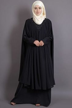 Beaded on neck band, double layer flare black Abaya gather at neck extra flare front and back with upper light weight georgette to flow in style , pull from neck to wear , handy fabric to care. New Abaya Style, Hijab Style Dress, Mode Abaya, Mode Hijab, Abaya Designs Dubai, Niqab Fashion, Dress Fashion, Black Abaya, Kaftan Abaya