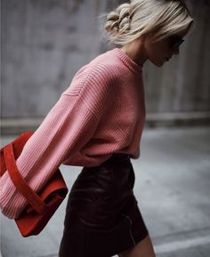 pink sweater tucked in