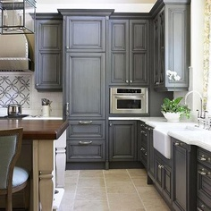 I want to re-finish our kitchen cabinets to Charcoal like this!!!  Love!