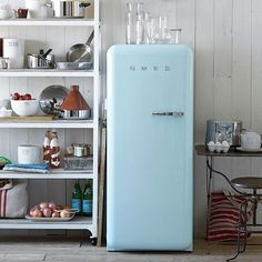 A blue fridge is a recipe for success in life.  SMEG Refrigerator - Pastel Blue