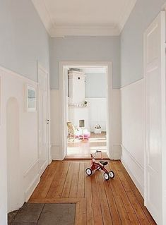 love the high wainscoting and the warm pale blue walls above. Makes a living space airy and filled with light - something Scandinavians strive for in a dark climate! Hall Colour, Hallway Colours, Picture Rail, Home Decor Inspiration, Interior Design Living Room, Ideal Home, New Homes, Room Decor, House Design